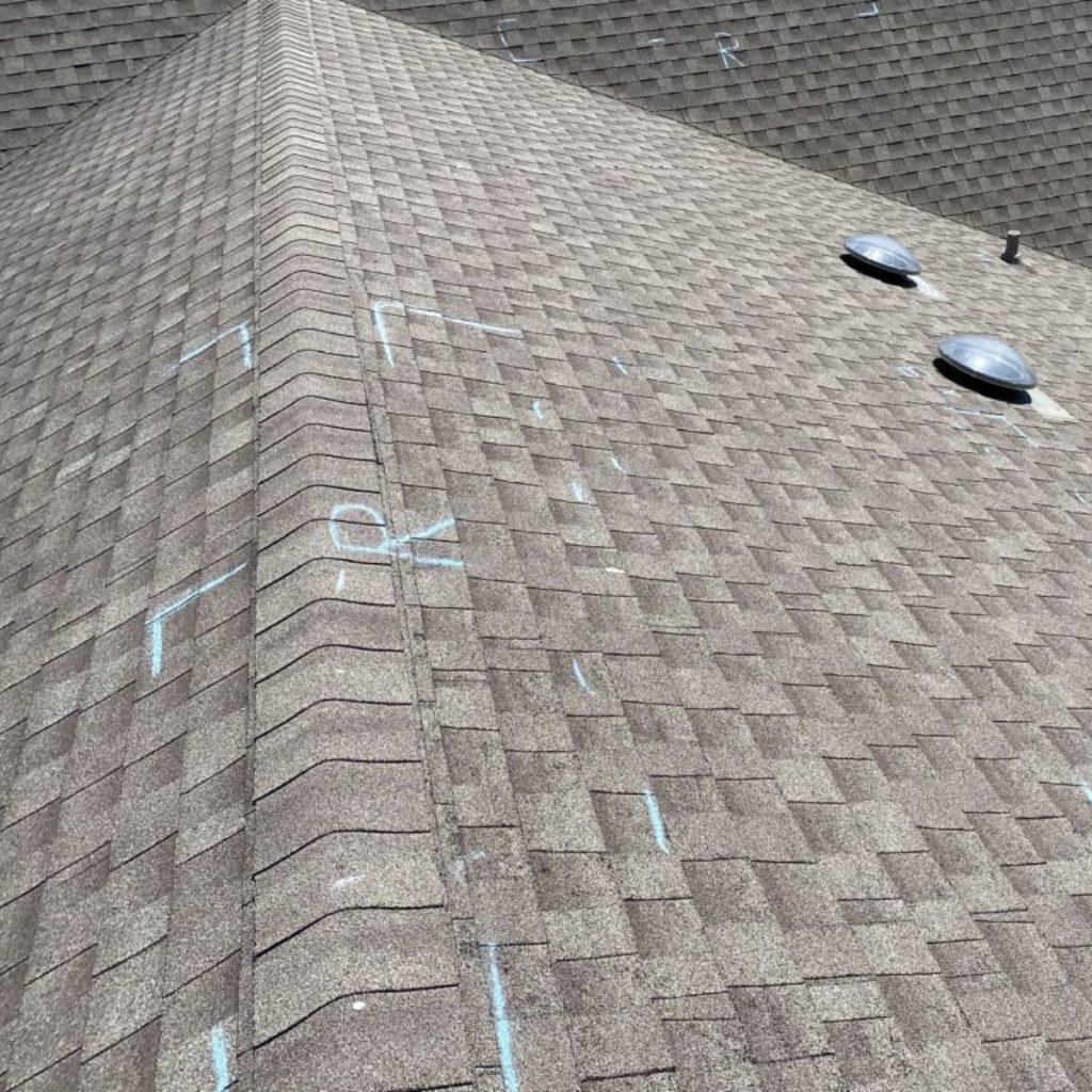 Hail damage on a shingle roof top