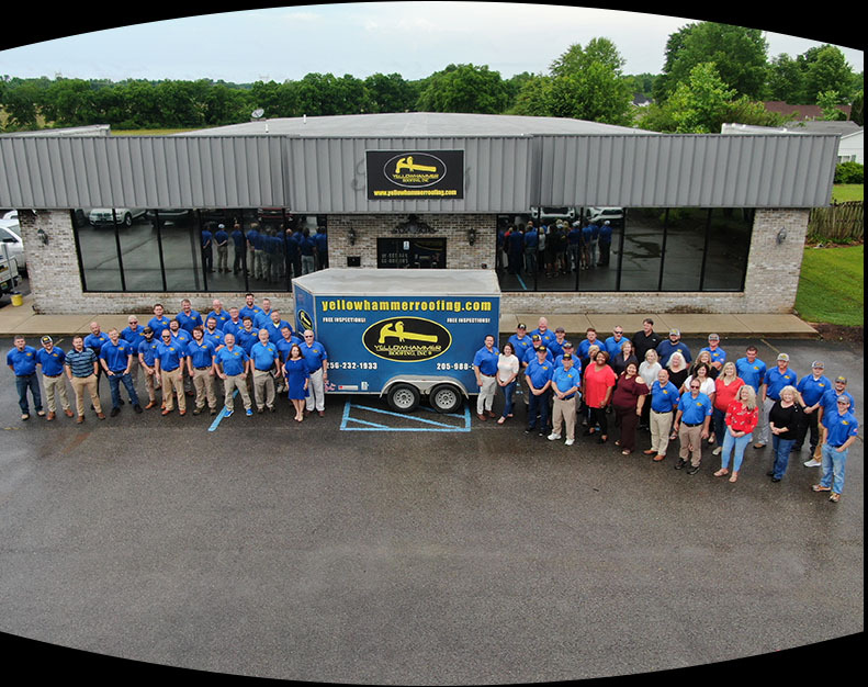 Yellowhammer Roofing Inc. team standing in front of their office building.